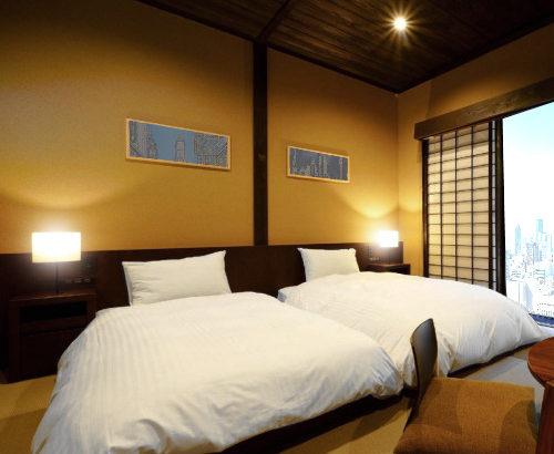 和室にベッドやマットレスを置いて、落ち着ける和風空間作りを実現する方法~古民家リニューアル宿泊施設~